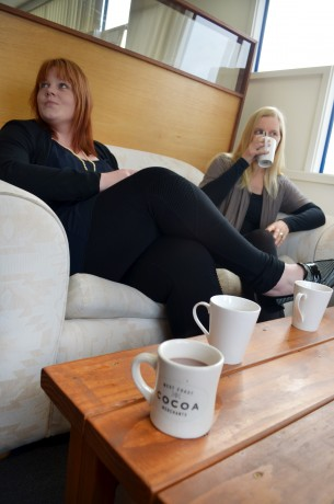 Two women drinking hot chocolate